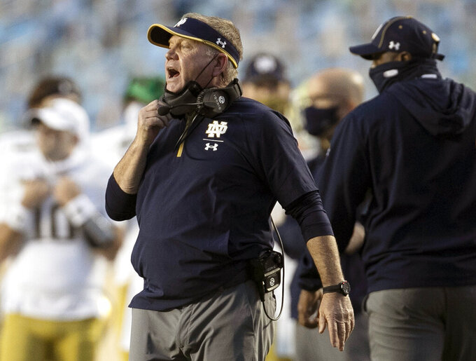 FILE - In this Nov. 27, 2020, file photo, Notre Dame head coach Brian Kelly directs his team during the second quarter of an NCAA college football game against North Carolina at Kenan Stadium in Chapel Hill, N.C. (Robert Willett/The News & Observer via AP, File
