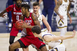 North Carolina State's Manny Bates, left, gets pressure from Notre Dame's Nate Laszewski, center, and Cormac Ryan during the first half of an NCAA college basketball game Wednesday, March 3, 2021, in South Bend, Ind. (AP Photo/Robert Franklin)