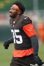 Cleveland Browns defensive end Myles Garrett smiles during an NFL football practice, Thursday, July 29, 2021, in Berea, Ohio. (AP Photo/Tony Dejak)
