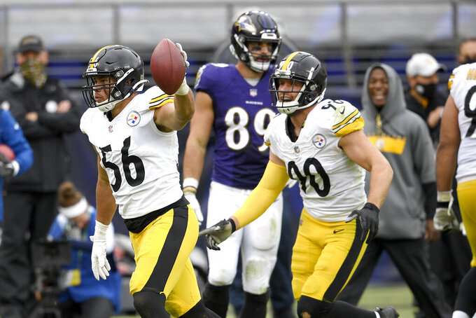 Pittsburgh Steelers linebacker Alex Highsmith (56) reacts after intercepting a pass from Baltimore Ravens quarterback Lamar Jackson, not visible, during the second half of an NFL football game, Sunday, Nov. 1, 2020, in Baltimore. (AP Photo/Nick Wass)