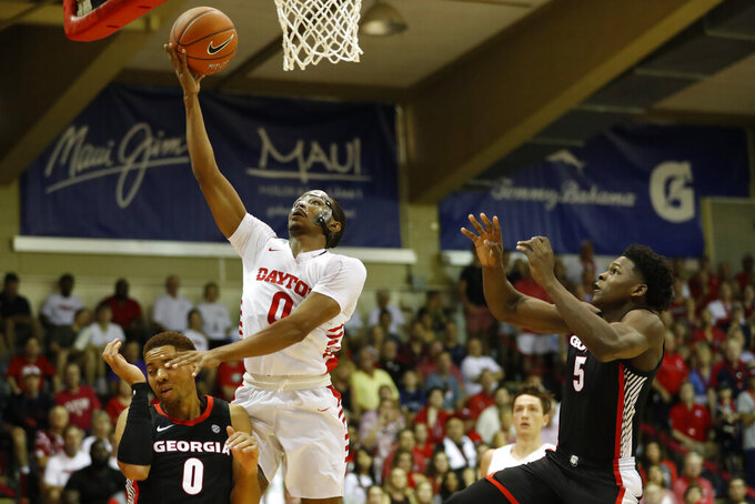 Dayton guard Rodney Chatman (0) goes to the basket between Georgia guards Donnell Gresham Jr. (0) and Anthony Edwards (5) during the first half of an NCAA college basketball game Monday, Nov. 25, 2019, in Lahaina, Hawaii. (AP Photo/Marco Garcia)