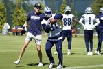 Dallas Cowboys running back Ezekiel Elliott (21) catches a ball as the team runs through drills during practice at the team's NFL football training facility in Frisco, Texas, Thursday, Sept. 23, 2021. (AP Photo/Tony Gutierrez)