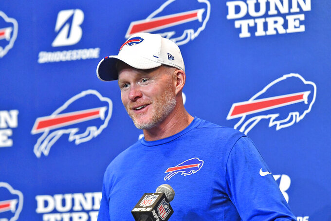 FILE - In this Aug. 8, 2019, file photo, Buffalo Bills head coach Sean McDermott talks to reporters after an NFL preseason football game against the Indianapolis Colts, in Orchard Park, N.Y. The New York Jets made lots of major changes in the offseason. The Buffalo Bills did, too. The AFC East rivals are looking for much better results this season _ starting with Sunday's opening game at MetLife Stadium. (AP Photo/Adrian Kraus, File)