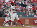 Philadelphia Phillies' Maikel Franco hits a grounder that drove in a run during the second inning of a baseball game against the St. Louis Cardinals, Tuesday, May 7, 2019, in St. Louis. Franco reached on a fielder's choice. (AP Photo/Tom Gannam)