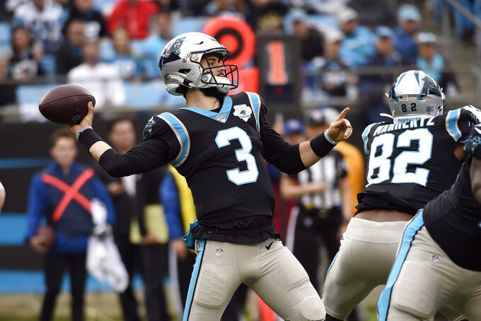 Carolina Panthers quarterback Will Grier (3) passes against the New Orleans Saints during the first half of an NFL football game in Charlotte, N.C., Sunday, Dec. 29, 2019. (AP Photo/Mike McCarn)