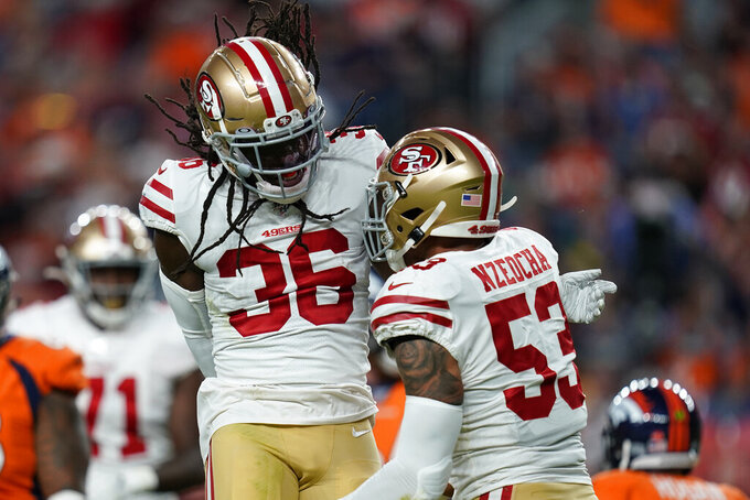 San Francisco 49ers outside linebacker Mark Nzeocha (53) celebrates his sack against the Denver Broncos with defensive back Marcell Harris (36) during the second half of an NFL preseason football game, Monday, Aug. 19, 2019, in Denver. (AP Photo/Jack Dempsey)