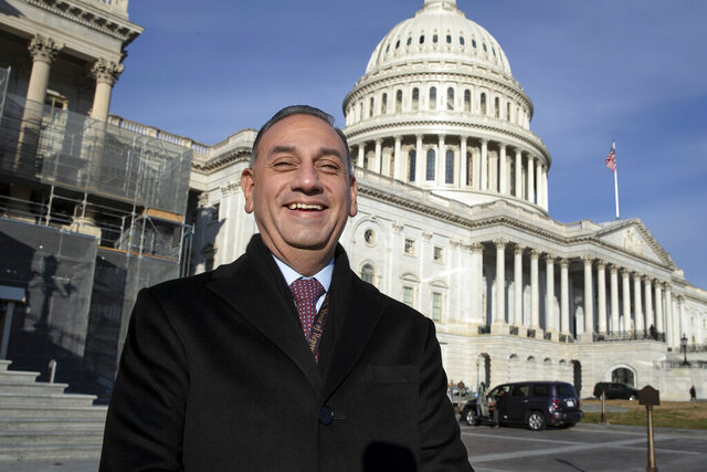 FILE - In this Nov. 29, 2018, file photo, then-Rep.-elect Gil Cisneros, D-Calif., stands in front of the Capitol during a week of orientation for incoming members, in Washington. Republicans are eager to recapture a string of California U.S. House seats a that the party lost in a 2018 rout, but the job is looking tougher: The numbers are running against them. State voter registration statistics show Democrats gaining ground in key battleground districts that the party seized two years ago, on its way to regaining control of the House. (AP Photo/J. Scott Applewhite, File)