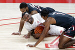 Houston guard DeJon Jarreau, middle, vies for a loose ball with South Carolina guard Seventh Woods (23) and guard T.J. Moss (1) during the first half of an NCAA college basketball game Saturday, Dec. 5, 2020, in Houston. (AP Photo/Michael Wyke)