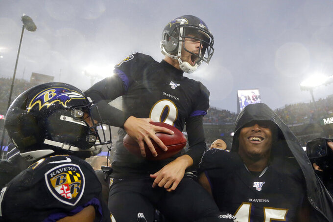 FILE - In this Dec. 1, 2019, file photo, Baltimore Ravens kicker Justin Tucker (9) is carried off field by his teammates after making a game winning field goal against the San Francisco 49ers in an NFL football game in Baltimore, Md. Baltimore won 20-17. Tucker was selected to the 2010s NFL All-Decade Team announced Monday, April 6, 2020, by the NFL and the Pro Football Hall of Fame. (AP Photo/Julio Cortez, File)