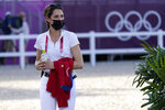 United States' Jessica Springsteen walks the course ahead of the equestrian jumping individual qualifying at Equestrian Park in Tokyo at the 2020 Summer Olympics, Tuesday, Aug. 3, 2021, in Tokyo, Japan. (AP Photo/Carolyn Kaster)
