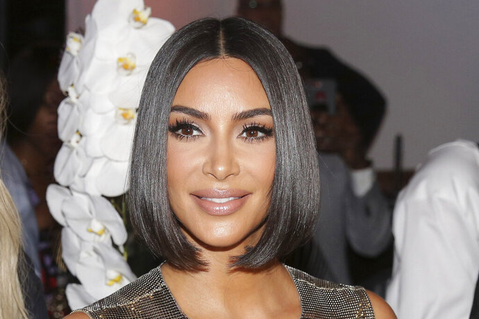 FILE - This Sept. 10, 2019, file photo shows Kim Kardashian arriving to the Serena Williams fashion show during Fashion Week in New York. Kim Kardashian West is selling a stake in her beauty brand for $200 million, in a deal that values the TV reality star's three-year-old business at $1 billion. The buyer is Covergirl owner Coty Inc., which will get a 20% stake in KKW Beauty.  (AP Photo/Seth Wenig, File)