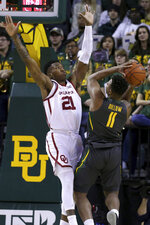 Oklahoma forward Kristian Doolittle (21) attempts to block the shot by Baylor guard Mark Vital (11) in the first half of an NCAA college basketball game Monday, Jan. 20, 2020, in Waco, Texas. (AP Photo/ Jerry Larson)