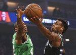 Sacramento Kings guard Buddy Hield, right, goes to the basket against Boston Celtics center Al Horford during the first quarter of an NBA basketball game Wednesday, March 6, 2019, in Sacramento, Calif. (AP Photo/Rich Pedroncelli)