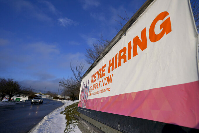 A sign announcing hiring is seen in the parking lot of a Home Depot, Monday, Feb. 22, 2021, in Cockeysville, Md. The number of Americans collecting unemployment benefits slid last week, another sign that the job market continues to recover rapidly from the coronavirus recession. Jobless claims dropped by 24,000 to 400,000 last week, the Labor Department reported Thursday, July 29, 2021. (AP Photo/Julio Cortez)