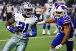 Dallas Cowboys running back Ezekiel Elliott (21) runs the ball as Buffalo Bills linebacker Matt Milano (58) gives chase in the second half of an NFL football game in Arlington, Texas, Thursday, Nov. 28, 2019. (AP Photo/Michael Ainsworth)
