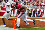 Alabama running back Najee Harris (22) levers his way into the end zone for a touchdown reception against Western Carolina during the first half of an NCAA college football game, Saturday, Nov. 23, 2019, in Tuscaloosa, Ala. (AP Photo/Vasha Hunt)
