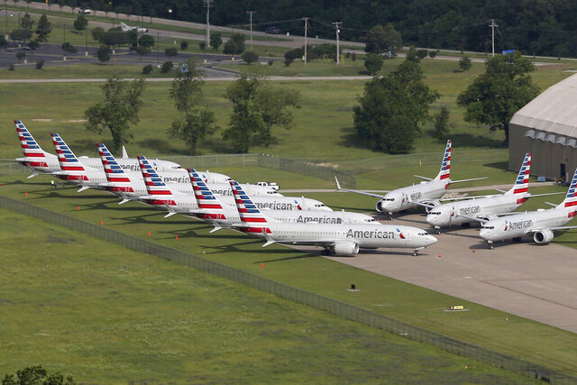 FILE - In this May 24, 2019, file photo, grounded Boeing 737 Max jets belonging to American Airlines are stored at Tulsa International Airport in Tulsa, Okla. American Airlines said Thursday, Jan. 2, 2020, it is negotiating with Boeing over compensation for the airline's grounded planes and will share some of the proceeds with its employees. (Tom Gilbert/Tulsa World via AP, File)