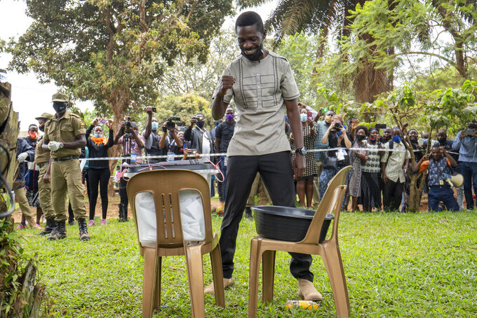 Uganda's leading opposition challenger Bobi Wine reacts after voting in Kampala, Uganda, Thursday, Jan. 14, 2021. Ugandans are voting in a presidential election tainted by widespread violence that some fear could escalate as security forces try to stop supporters of Wine from monitoring polling stations.(AP Photo/Jerome Delay)