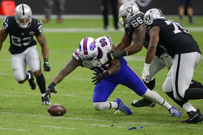 Buffalo Bills defensive tackle Quinton Jefferson (90) recovers a fumble by the Las Vegas Raiders during the second half of an NFL football game, Sunday, Oct. 4, 2020, in Las Vegas. (AP Photo/Isaac Brekken)