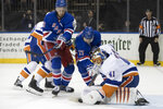 New York Islanders goaltender Jaroslav Halak (41) defends the net against New York Rangers right wing Jesper Fast (17) and center Kevin Hayes (13) during the second period of an NHL hockey game, Saturday, Jan. 13, 2018, at Madison Square Garden in New York. (AP Photo/Mary Altaffer)