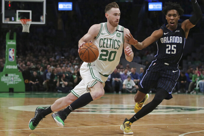 Boston Celtics forward Gordon Hayward (20) drives to the basket past Orlando Magic forward Wes Iwundu (25) during the second quarter of an NBA basketball game in Boston, Wednesday, Feb. 5, 2020. (AP Photo/Charles Krupa)