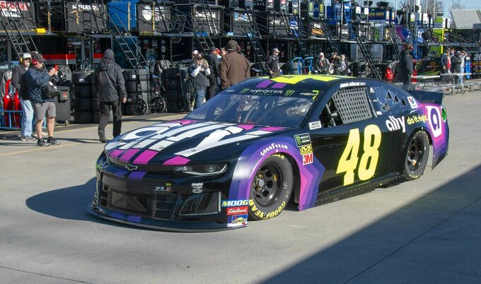 Jimmie Johnson passes through the garage area during practice for the NASCAR Monster Energy Cup Series race at Martinsville Speedway in Martinsville, Va., Saturday, March 23, 2019. (AP Photo/Matt Bell)