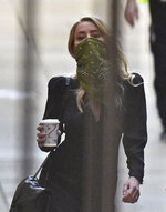 Actress Amber Heard arrives at the High Court in London for a hearing in Johnny Depp's libel case, Friday July 10, 2020.  Depp is back in the witness box at the trial of his libel suit against a tabloid newspaper that called him a