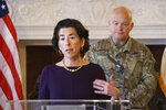 Rhode Island Governor Gina Raimondo addresses the media during a press at the State House in Providence. At rear right is Behind the Governor is Col. Christopher P. Callahan of the Rhode Island National Guard. (Sandor Bodo/Providence Journal via AP, Pool)