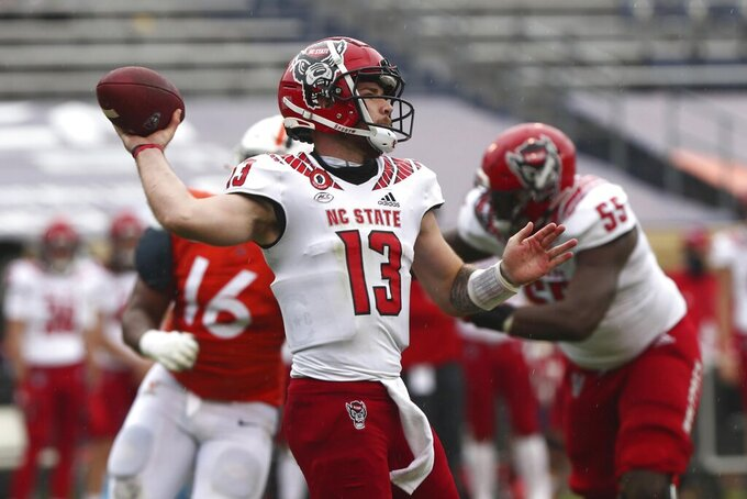 North Carolina State quarterback Devin Leary throws a pass against Virginia during an NCAA college football game, Saturday, Oct. 10, 2020, at Scott Stadium in Charlottesville, Va. (Erin Edgerton/The Daily Progress via AP)