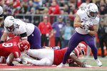 Northwestern running back Isaiah Bowser, right, avoids a tackle by Rutgers defensive lineman Julius Turner during the second half of an NCAA college football game, Saturday, Oct. 20, 2018, in Piscataway, N.J. Northwestern won 18-15. (AP Photo/Julio Cortez)