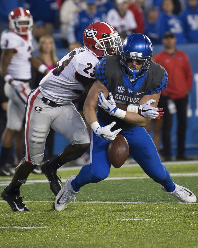 Georgia defensive back Mark Webb (23) breaks up a pass to Kentucky tight end C.J. Conrad (87) during the second half an NCAA college football game in Lexington, Ky., Saturday, Nov. 3, 2018. (AP Photo/Bryan Woolston)