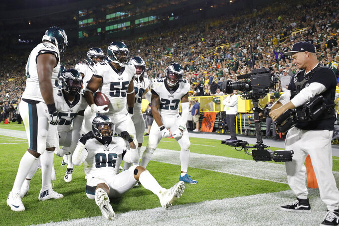 The Philadelphia Eagles defense celebrates a fumble recovery during the first half of the team's NFL football game against the Green Bay Packers on Thursday, Sept. 26, 2019, in Green Bay, Wis. (AP Photo/Jeffrey Phelps)