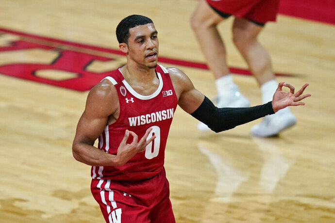 Wisconsin's D'Mitrik Trice reacts after sinking a 3-point basket during the second half of the team's NCAA college basketball game against Rutgers, Friday, Jan. 15, 2021, in Piscataway, N.J. Wisconsin won 60-54. (AP Photo/Seth Wenig)