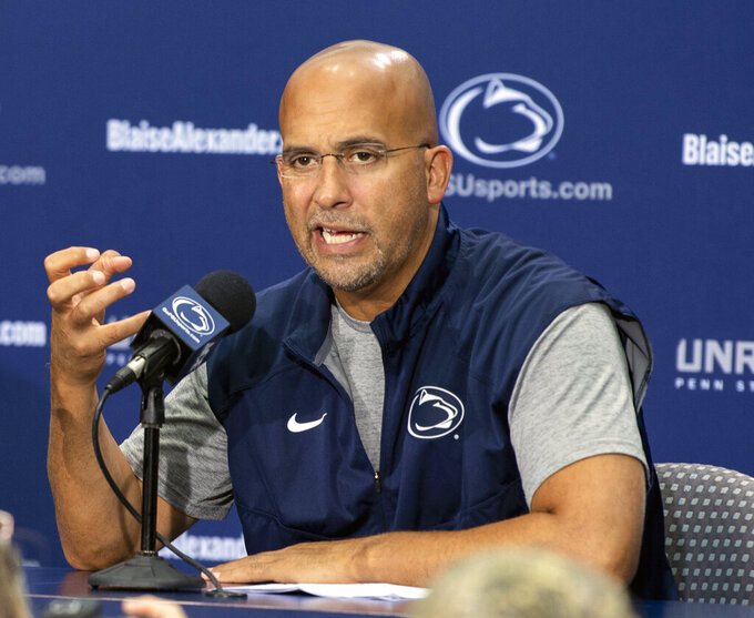 FILE - In this Aug. 4, 2018, file photo, Penn State head coach James Franklin speaks with media in State College, Pa. Franklin has expanded Penn State's recruiting base from the Northeast. His class is made up of players from 11 states, including Florida and Oregon. (Ty Lohr/York Daily Record via AP, File)