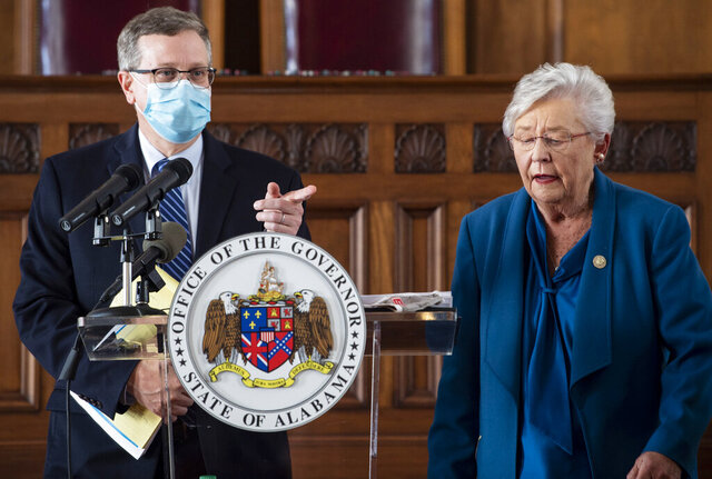 Gov. Kay Ivey and Alabama Health Officer Dr. Scott Harris answer questions during a news conference update on COVID-19 restrictions at the Alabama State Capitol in Montgomery, Ala., on Thursday, Nov. 5, 2020. (Jake Crandall/The Montgomery Advertiser via AP)