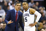 FILE - In this Wednesday, Feb. 20, 2019, file photo, Villanova head coach Jay Wright talks with guard Phil Booth (5) during the first half of an NCAA college basketball game against Georgetown in Washington. Villanova opens their Big East conference tournament play on Thursday, March 14, 2019.  (AP Photo/Nick Wass, File)