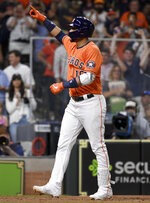 Houston Astros' Yuli Gurriel celebrates after his two-run home run during the fifth inning of baseball game against the Toronto Blue Jays, Friday, May 7, 2021, in Houston. (AP Photo/Eric Christian Smith)