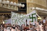 """People stage a protest against the """"green pass"""" in Milan, Italy, Saturday, July 24, 2021. Italy's government approved a decree ordering the use of the so-called """"green"""" passes starting on Aug. 6. To be eligible for a pass, individuals must prove they have received at least one vaccine dose in the last nine months, recovered from COVID-19 in the last six months or tested negative in the previous 48 hours. The passes will be needed to dine at tables inside restaurants or cafes, to attend sports events, town fairs and conferences, and to enter casinos, bingo parlors and pools, among other activities. according to officials. (AP Photo/Antonio Calanni)"""