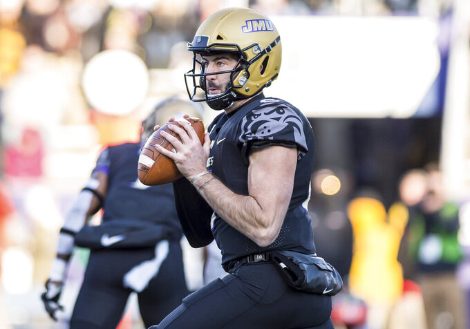 James Madison quarterback Ben DiNucci (6) looks to throw during the first half of an NCAA college football game in Harrisonburg, Va, Saturday, Nov. 16, 2019. (Daniel Lin/Daily News-Record via AP)