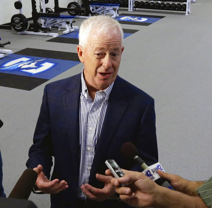 FILE - In this June 6, 2014, file photo, Bruce Rasmussen, Creighton University's athletic director, speaks to reporters at the Athletic Performance Center in Omaha, Neb. Creighton University's athletic director who oversaw the rise of the school's men's basketball team and its transition to the Big East Conference during his tenure over the past 27 years will retire next month. Bruce Rasmussen, 70, announced his retirement plans Monday morning, July 19, 2021. (AP Photo/Nati Harnik, File)