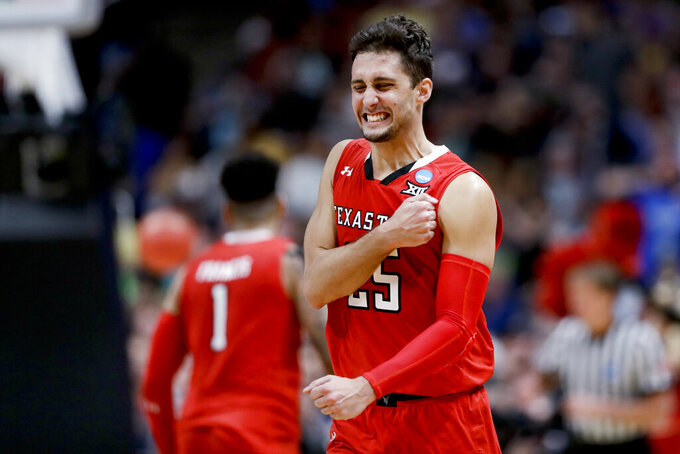 FILE - In this March 30, 2019, file photo, Texas Tech guard Davide Moretti celebrates after scoring against Gonzaga during the second half of regional final in the NCAA college basketball tournament in Anaheim, Calif. (AP Photo/Marcio Jose Sanchez, File)