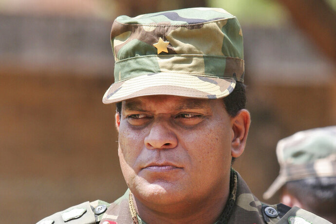 "FILE - This April 24, 2009, file photo shows Sri Lanka's Lt. Gen. Shavendra Silva at a military facility in Kilinochchi, Sri Lanka.  The U.S. government on Friday, Feb. 14, 2020,  issued a travel ban on Sri Lanka's army chief, saying there is ""credible information of his involvement"" in human rights violations during the final phase of the island nation's civil war that ended 11 years ago, Secretary of State Michael R. Pompeo said.  Silva, and his immediate family members are now prohibited from traveling to the U.S. in a ban that was quickly denounced by Sri Lanka's government, which said ""there were no substantiated or proven allegations of human rights violations"