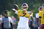 Washington quarterback Dwayne Haskins Jr. (7) looks to pass during practice at the team's NFL football training facility, Monday, Aug. 24, 2020, in Ashburn, Va. (AP Photo/Nick Wass)