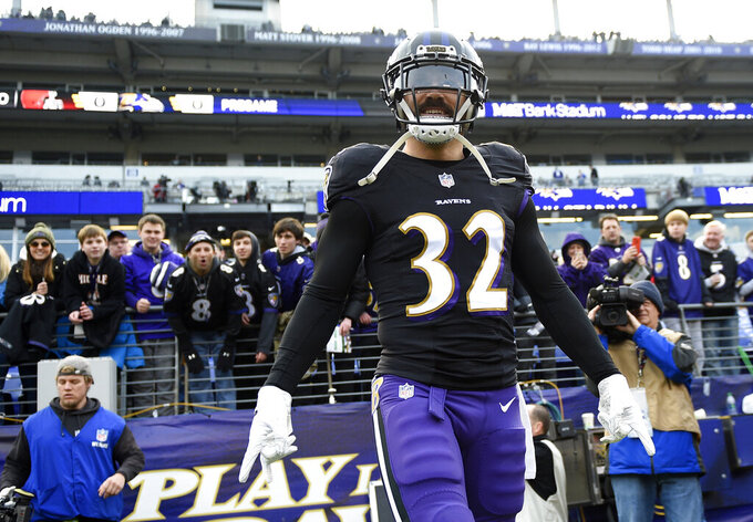 FILE - In this Dec. 30, 2018, file photo, Baltimore Ravens free safety Eric Weddle walks onto the field before the team's NFL football game against the Cleveland Browns in Baltimore. The Los Angeles Rams have signed veteran safety Weddle to a two-year deal, the team announced Friday, March 8, 2019. Weddle has been chosen for six Pro Bowls during a 12-year NFL career spent with San Diego and Baltimore. The Ravens cut him Tuesday. (AP Photo/Nick Wass, File)