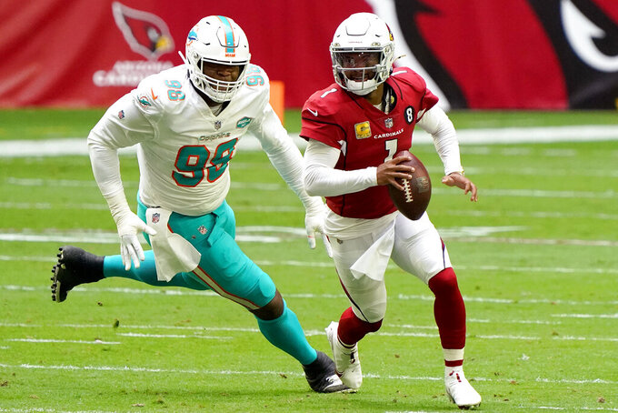 Arizona Cardinals quarterback Kyler Murray (1) scrambles as DUPLICATE***Miami Dolphins defensive tackle Raekwon Davis (98) pursues during the first half of an NFL football game, Sunday, Nov. 8, 2020, in Glendale, Ariz. (AP Photo/Rick Scuteri)