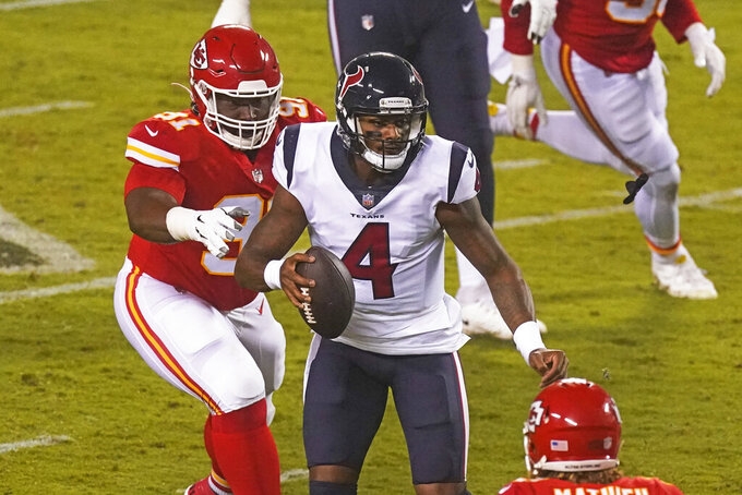 Houston Texans quarterback Deshaun Watson (4) is pressured by Kansas City Chiefs defensive tackle Derrick Nnadi (91) in the first half of an NFL football game Thursday, Sept. 10, 2020, in Kansas City, Mo. (AP Photo/Charlie Riedel)