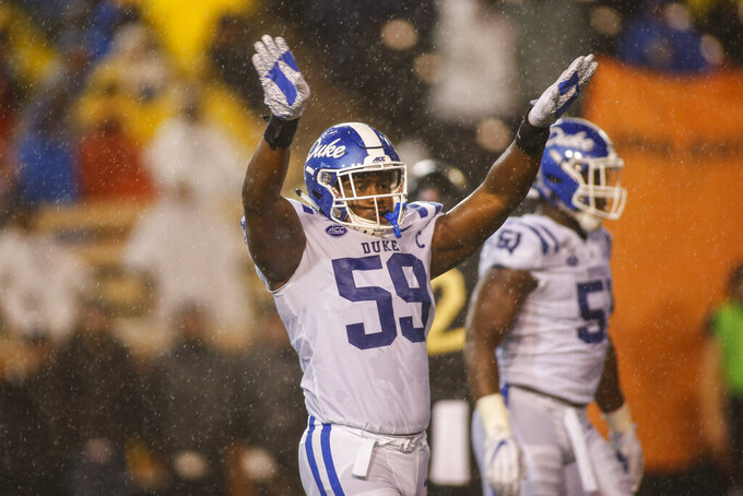 Duke defensive end Tre Hornbuckle (59) reacts after a defensive stop against Wake Forest in the first half of an NCAA college football game in Winston-Salem, N.C., Saturday, Nov. 23, 2019. (AP Photo/Nell Redmond)