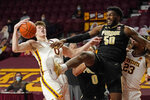 Minnesota's Liam Robbins (0) rears back after colliding with Purdue's Trevion Williams (50) in the first half of an NCAA college basketball game, Thursday, Feb. 11, 2021, in Minneapolis. (AP Photo/Jim Mone)