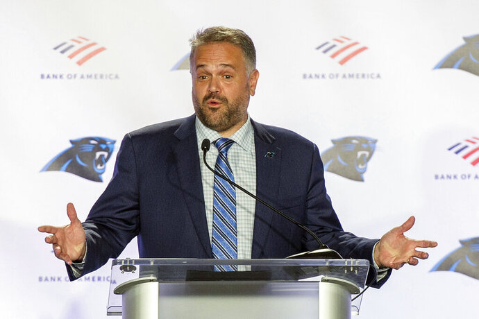 FILE - In this Jan. 8, 2020, file photo, Carolina Panthers NFL football team head coach Matt Rhule talks to the media during a news conference at the teams practice facility in Charlotte, N.C. Rhule said he is considering kneeling alongside his players for the national anthem this season to support the movement against racial injustice. (AP Photo/Mike McCarn, File)