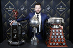 Tampa Bay Lightning's Nikita Kucherov poses with, from left, the Ted Lindsay Award, Hart Memorial Trophy and the Art Ross Trophy after winning the honors at the NHL Awards, Wednesday, June 19, 2019, in Las Vegas. (AP Photo/John Locher)